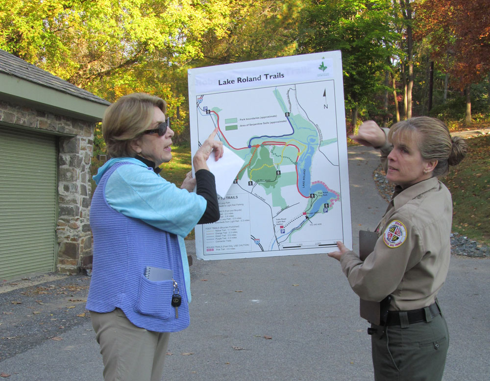 Nancy Horst (L) and Park Ranger Shannon Davis show map of park trails to participants before setting off on the Friday morning walk.